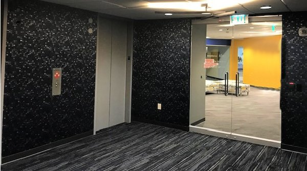 Telecommunication Company Headquarters elevator lobby finished general contracting project by The Blue River Group