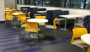 Telecommunication Company Headquarters employee lounge of a general contracting project by The Blue River Group