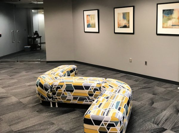 A custom yellow and grey geometric settee in the lobby of a Blue River Group General Contracting Project