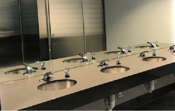 Telecommunication Company Headquarters finished employee bathroom by The Blue River Group